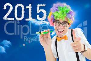 Composite image of geek ready to party