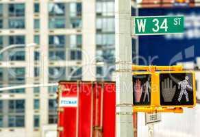 Street sign on the corner of 34st Street in Manhattan, New York