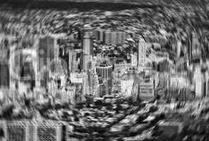 Motion blurred image of New York buildings from helicopter