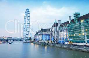 LONDON - SEPTEMBER 27, 2013: Tourists walk along river Thames in