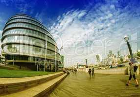LONDON - SEPTEMBER 27, 2013: Tourists walk along river Thames ne