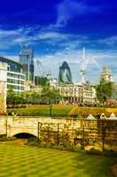 Gardens of Tower of London with city skyline on background