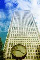Clock and Skyscrapers at Canary Wharf, financial district in Lon