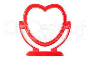 Mirror in the red heart frame isolated on white background