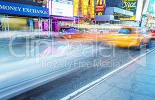 NEW YORK CITY - JUNE 11, 2013: Taxi cabs speed up along city str