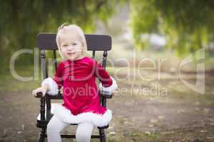 Adorable Little Girl Sitting in Her Chair Outside