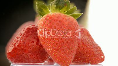 Delicious strawberries, close up. Loop
