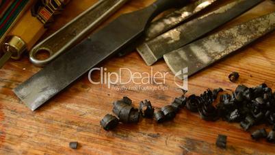 Ebony wood shaving and carpentry's tools like background