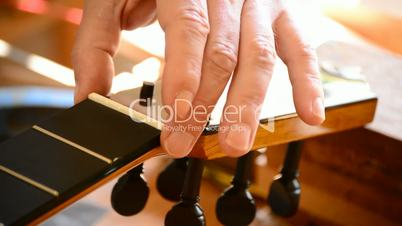 Luthier placing the bone of a spanish guitar