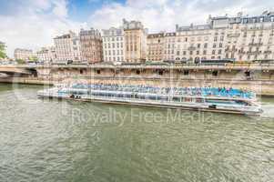 PARIS - JUNE 19, 2014: Bateau Mouche on the river. Bateaux Mouch