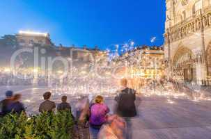 PARIS - JUNE 21, 2014: Tourists enjoy summer night lights show i