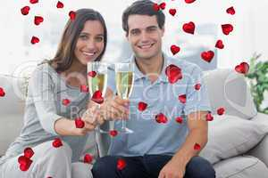 Composite image of portrait of lovers toasting their flutes of c