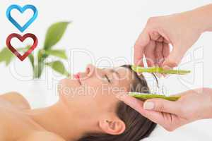 Composite image of attractive young woman receiving aloe vera ma