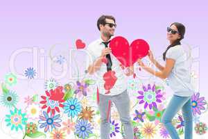 Composite image of hipster couple smiling at camera holding a he