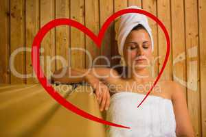 Composite image of calm woman relaxing in a sauna