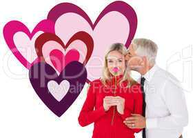 Composite image of handsome man giving his wife a kiss on cheek
