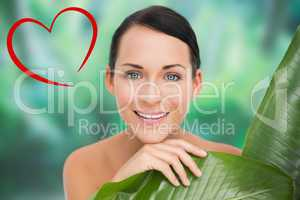 Composite image of beautiful nude brunette posing with green lea