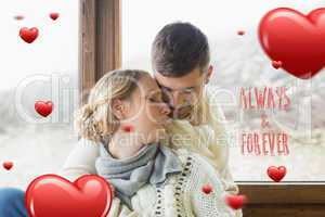 Composite image of close up of a loving young couple in winter c
