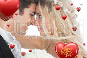 Composite image of happy young married couple looking each other