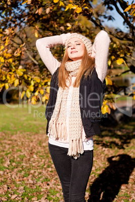 young woman in autumn sunshine outdoor
