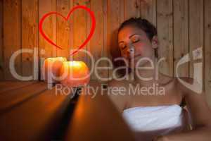 Composite image of happy brunette woman sitting in a sauna