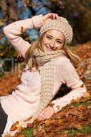 young smiling woman with hat and scarf outdoor in autumn