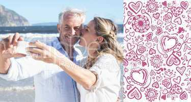 Composite image of married couple at the beach together taking a