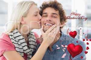 Composite image of woman kissing man on his cheek