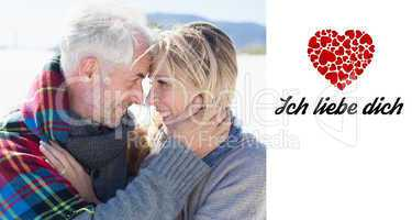 Composite image of happy married couple embracing on the beach