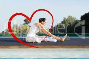 Composite image of peaceful brunette in janu sirsasana yoga pose