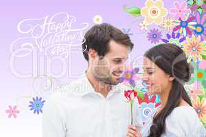 Composite image of handsome man offering his girlfriend a rose