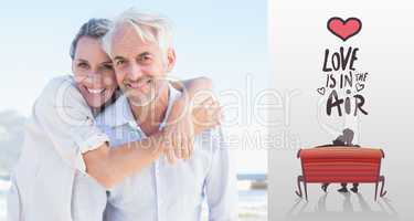 Composite image of attractive married couple posing at the beach