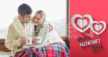 Composite image of loving couple in winter wear with cups agains