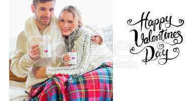 Composite image of loving couple in winter clothing with coffee