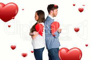 Composite image of side view of young couple holding broken hear