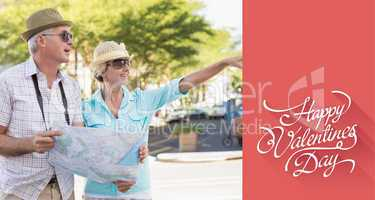 Composite image of happy tourist couple using map in the city
