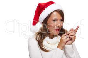 Attractive smiling woman in a Santa hat