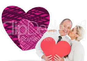 Composite image of older affectionate couple holding red heart s