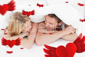 Composite image of lovely couple in their bed