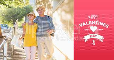 Composite image of happy tourist couple walking in the city