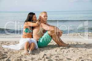 Happy young couple sunbathing