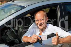 Excited driver holding the keys of his new car