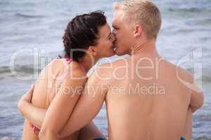 Romantic couple kissing at the seaside