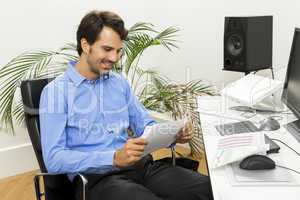 Young man reading written agreements for work