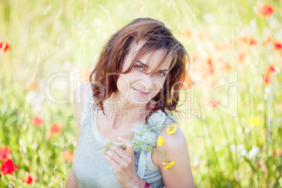 adult brunette woman smiling in summertime outdoor