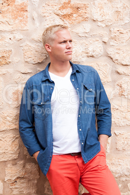 attractive young adult man standing outside