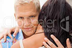 Romantic handsome man hugging his girlfriend