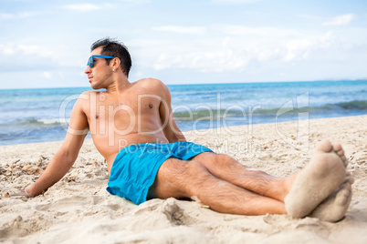 Handsome man relaxing on the beach