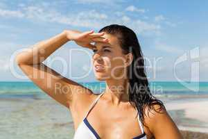 Young woman looking far away in the beach