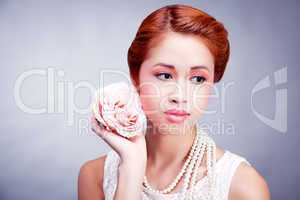 pretty asian woman with flower and pearls